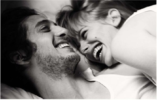 couple laughing in bed