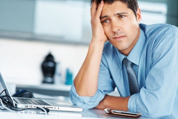 unhappy man at work
