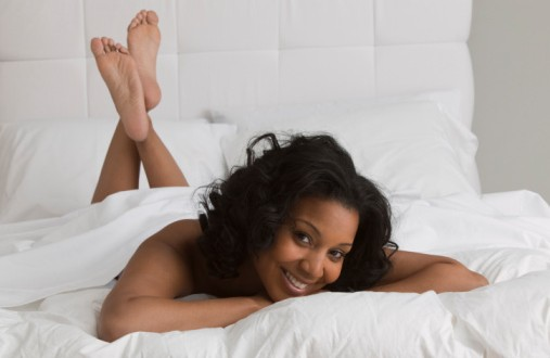 black woman in bed